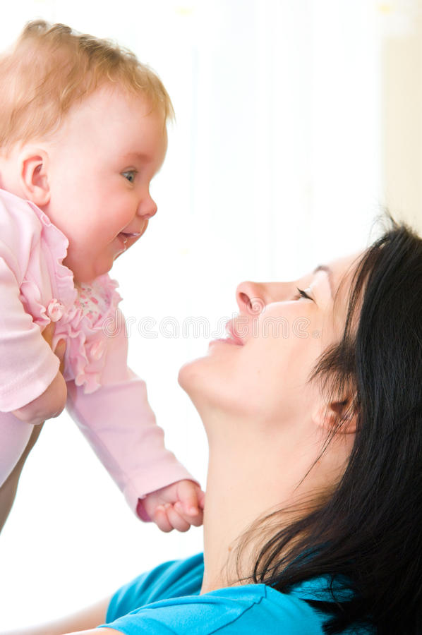 Download Mother with baby girl stock photo. Image of hold, white - 15532970