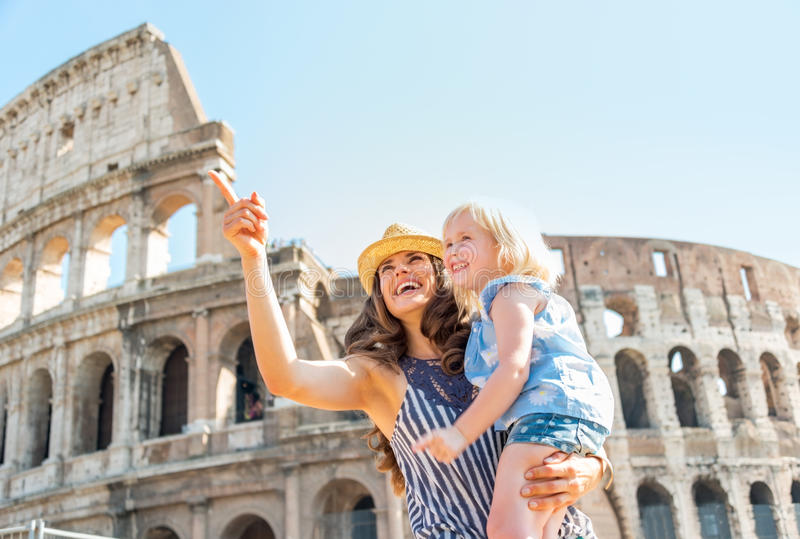 Mother and baby girl sightseeing near colosseum royalty free stock photos