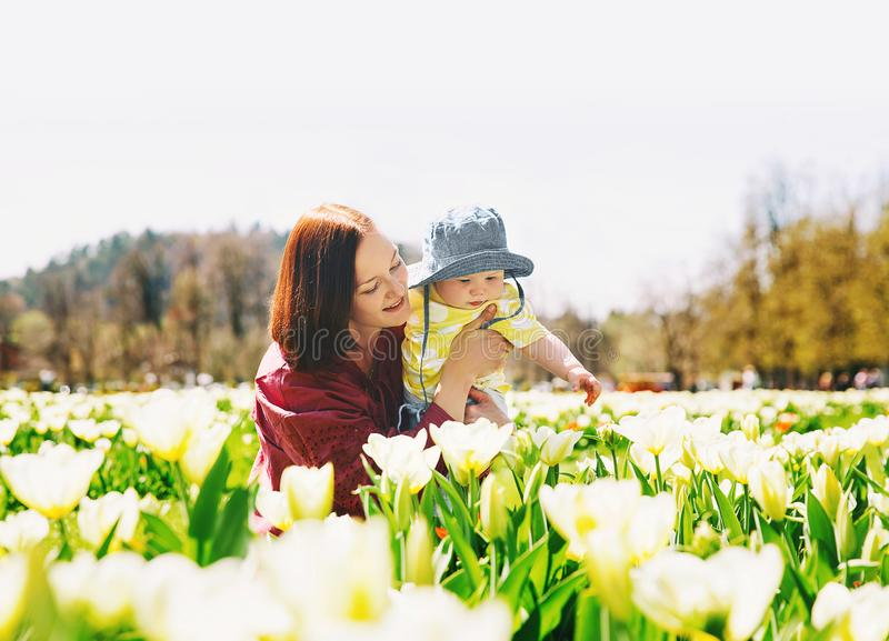 Mother and baby girl in spring park royalty free stock photo