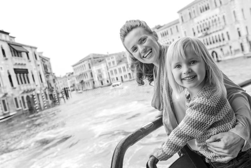 Mother and baby girl travel by venice water bus stock photography