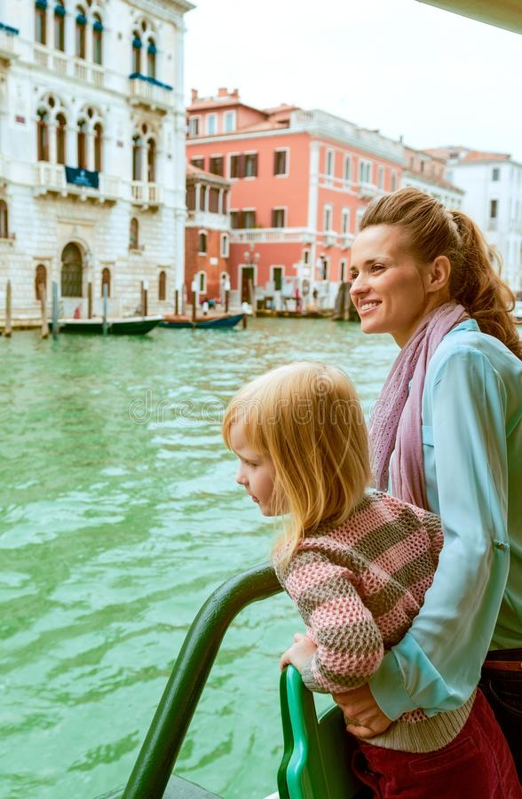 Mother and baby girl travel by venice water bus royalty free stock photography
