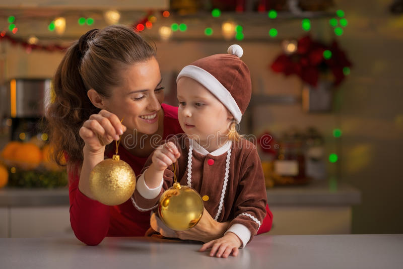 Mother and baby holding christmas balls stock photography