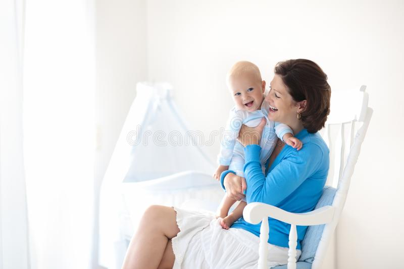 Mother and baby at home. Mom and child in bedroom. royalty free stock image