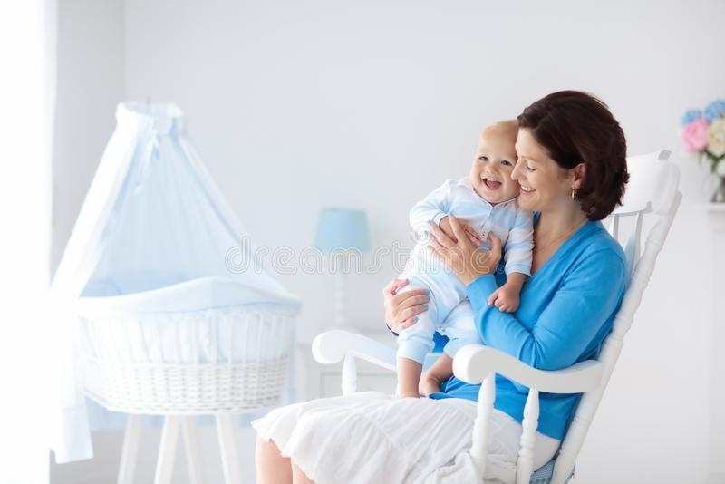 Mother and baby at home. Mom and child in bedroom. stock photos