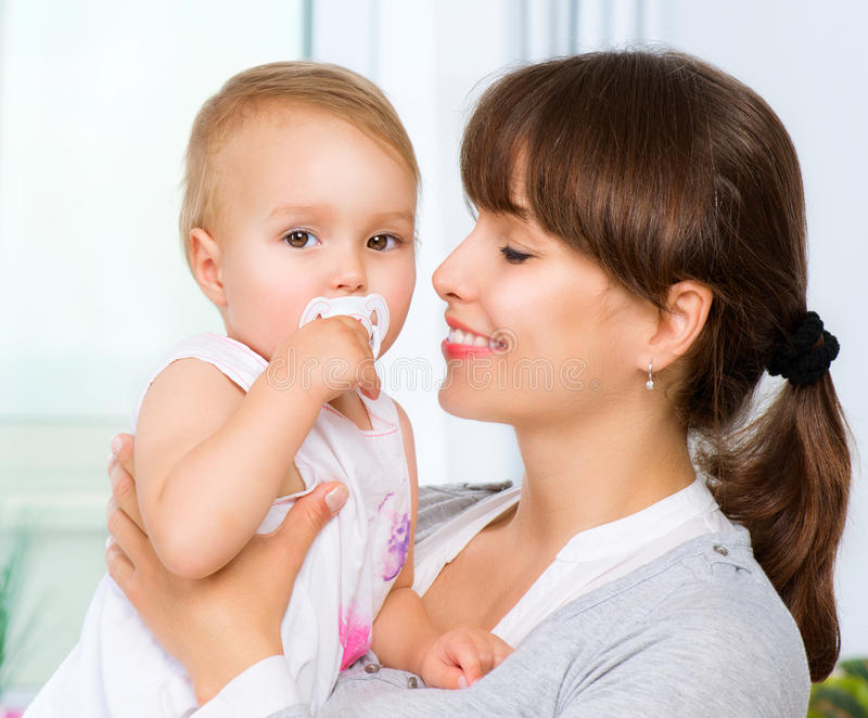 Mother and Baby. Kissing and hugging. Happy Family stock photo