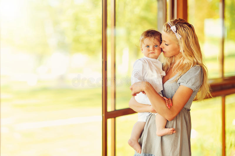 Mother and Baby kissing and hugging. Happy Family. Outdoors stock images