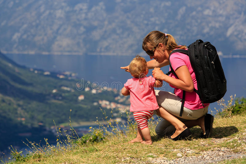 Mother with baby looking at mountains on vacation stock images