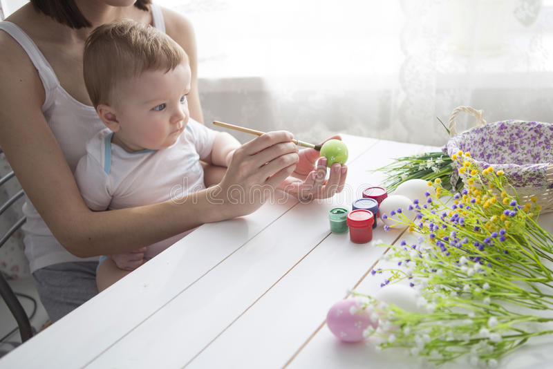 Mother and baby making easter decoration royalty free stock photo