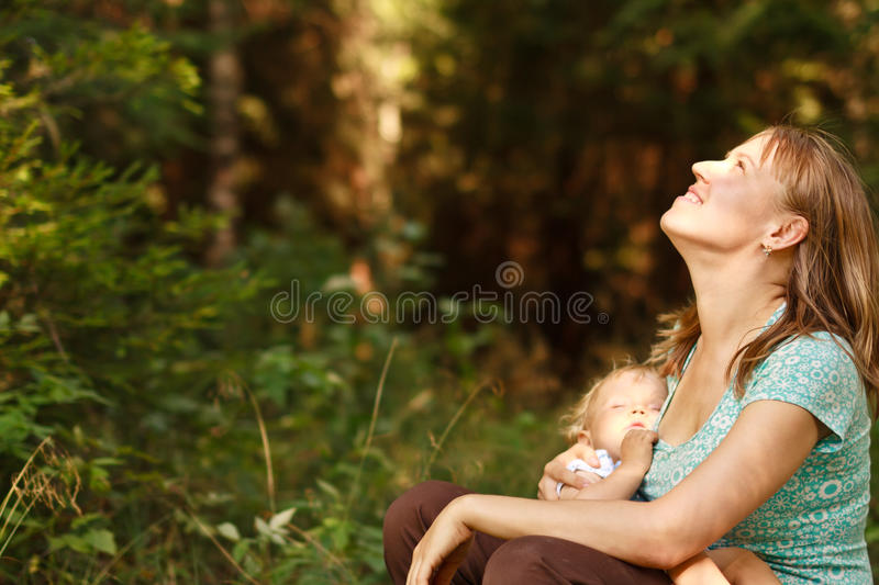 Mother and baby in nature stock image