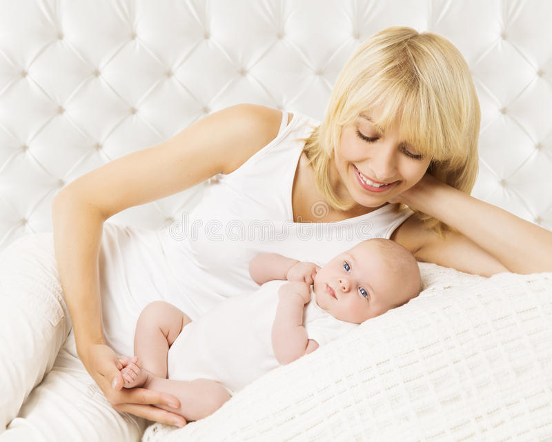 Mother And Baby Newborn, New Born with Mom. Mother And Baby Newborn, Lying New Born in Bodysuit, Mom with Kid on White stock image