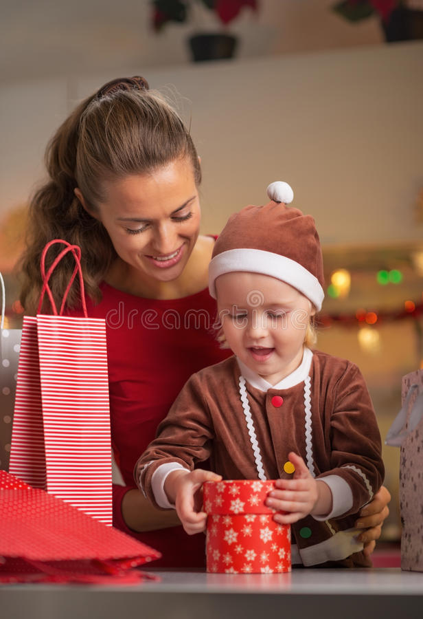 Mother and baby opening christmas present box stock photos