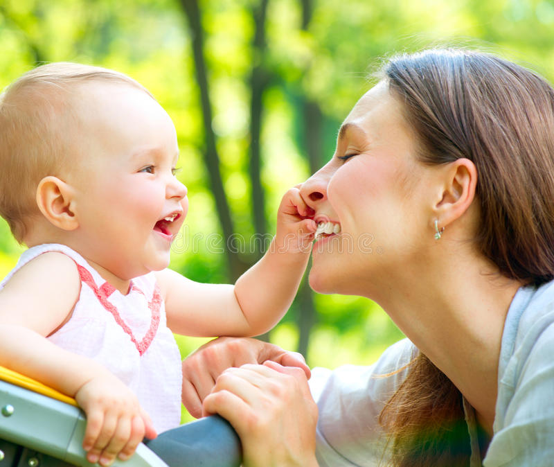 Mother And Baby outdoor. Beautiful Mother And Baby outdoors. Nature stock images