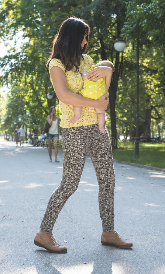 Mother and baby in a park royalty free stock photography