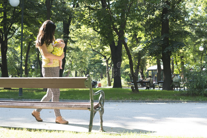 Mother and baby in a park royalty free stock photos