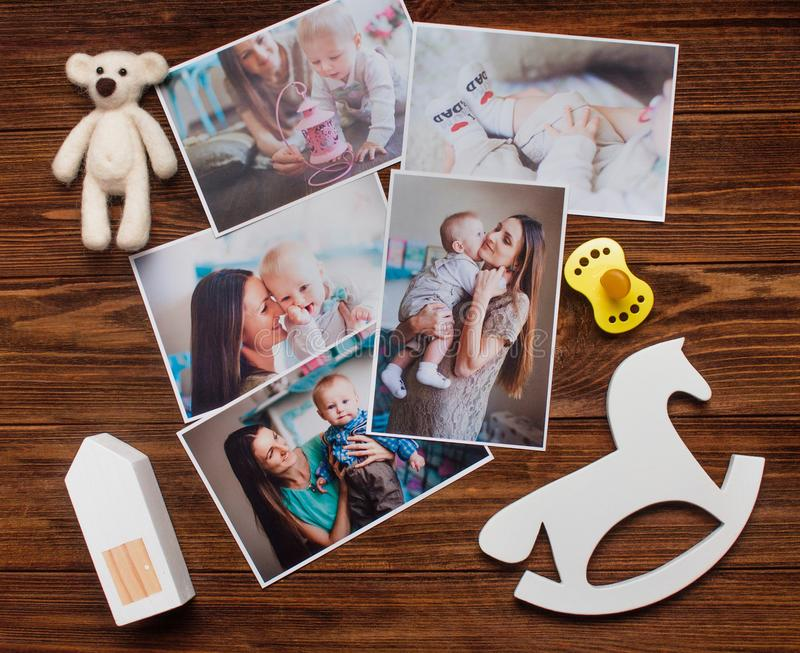 Mother and baby pictures and wooden toys on rustic wooden background royalty free stock photos