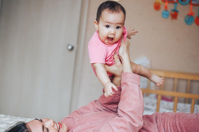 mother playing ang laughing with baby girl at home royalty free stock images