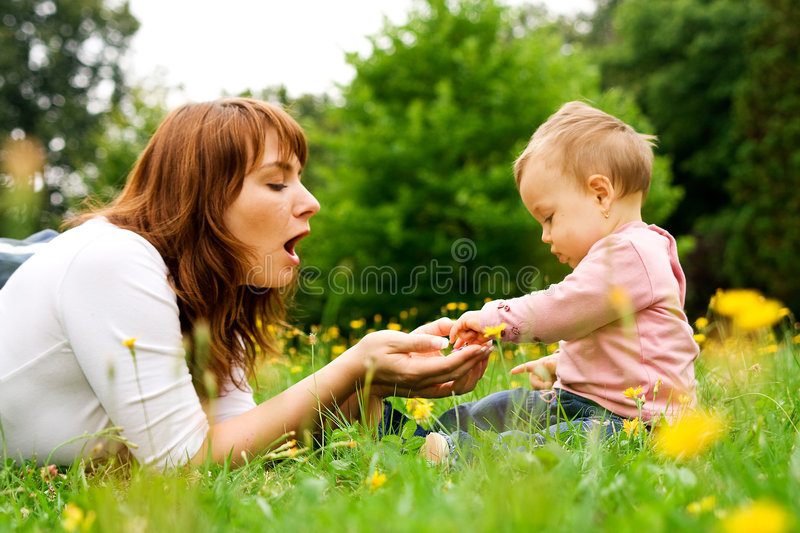 Mother and baby playing royalty free stock images