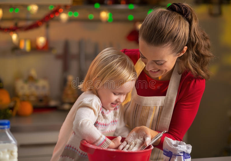 Mother and baby playing while making cookies royalty free stock images