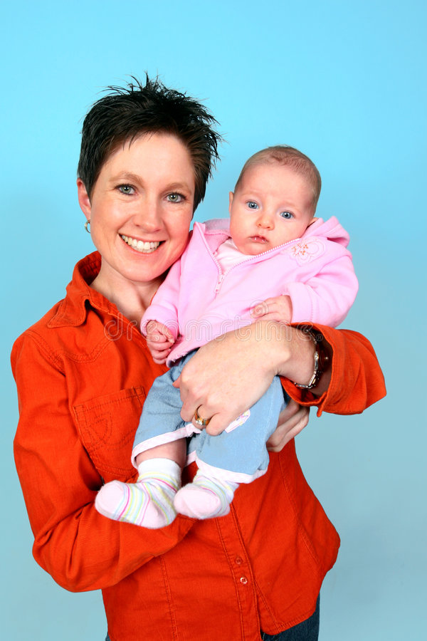 Mother with Baby posing. Young mother with baby stock photo