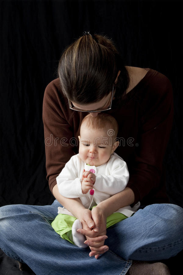 Mother and baby praying royalty free stock photos