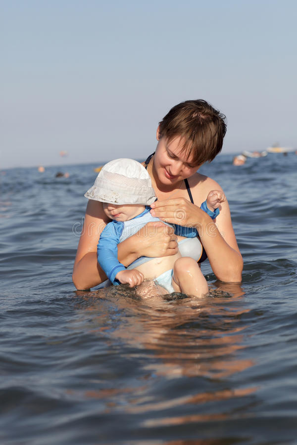 Download Mother with baby in sea stock image. Image of caucasian - 27095615