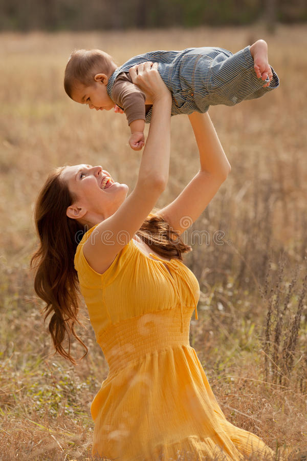Mother and Baby Son Outdoors stock photo