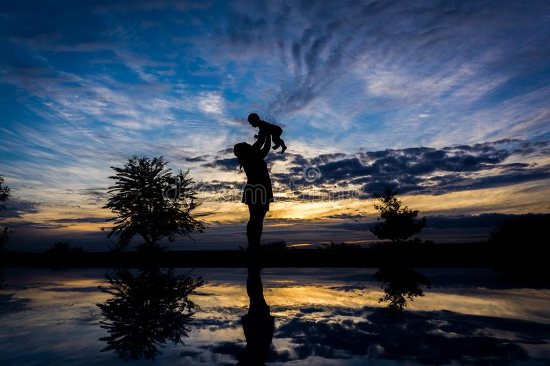 Mother with baby son at sunset royalty free stock photography