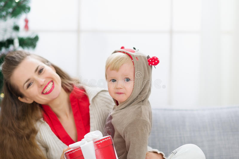 Mother and baby spending Christmas time together stock images
