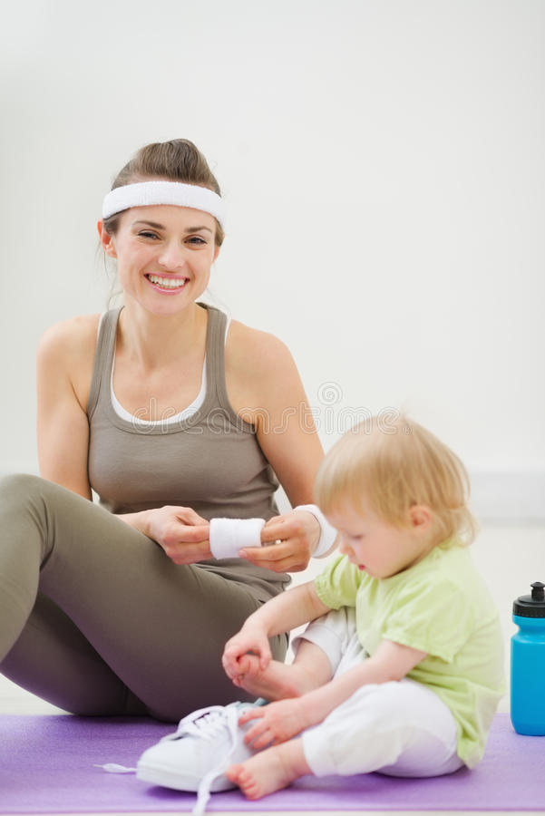 Mother And Baby Spending Time In Gym Royalty Free Stock Photo