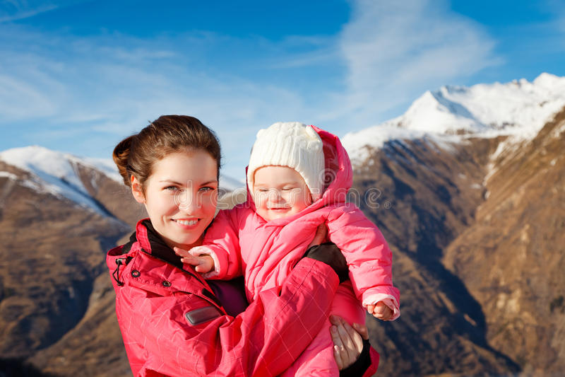Mother with baby in sport outwear