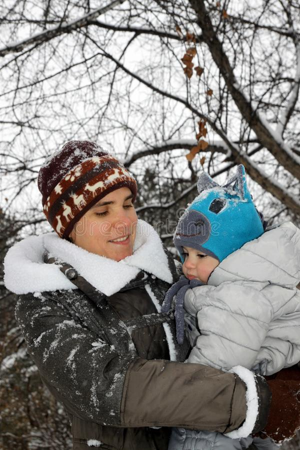 Mother and baby walk winter stock photography