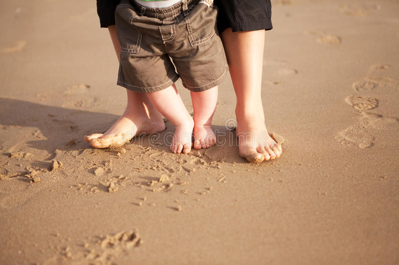 Mother and baby walking on beach royalty free stock photography