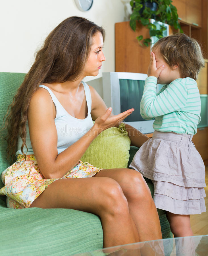 Mother berating little child stock photography