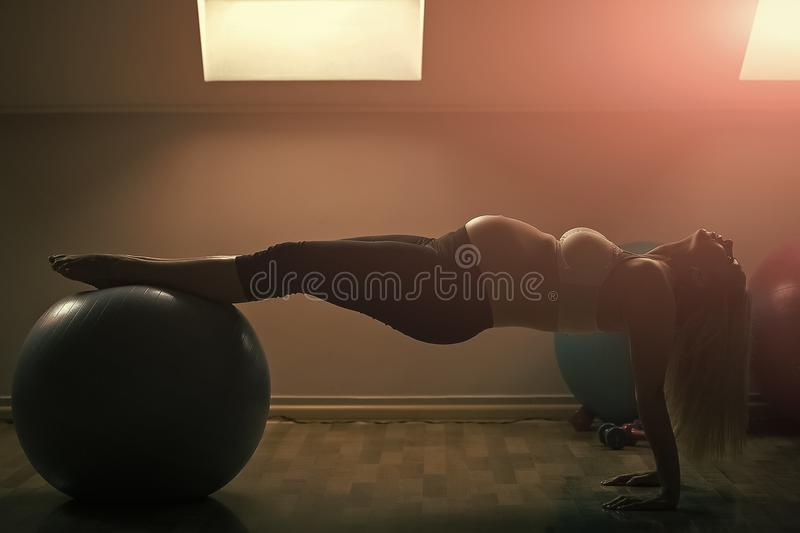 Mother with big belly expecting baby. Pregnant woman exercising with fit ball in gym. Prenatal fitness, yoga and healthy lifestyle. Motherhood and maternity stock images