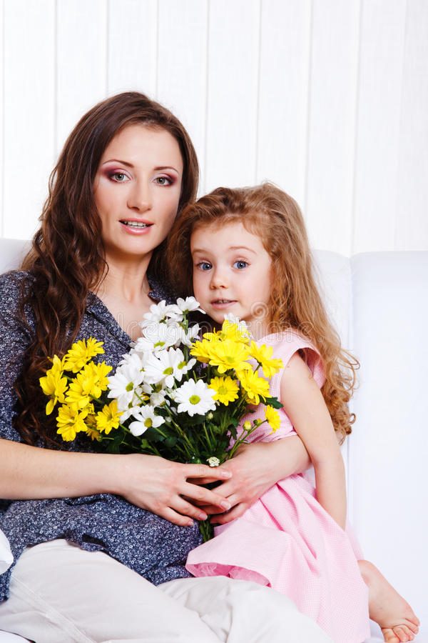 Mother with birthday flowers stock images