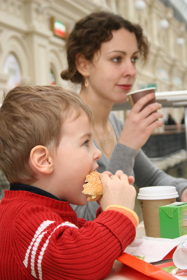 Mother with boy. In a cafe eating stock photos