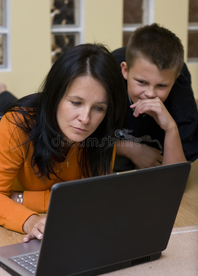 Mother and boy with laptop stock photos