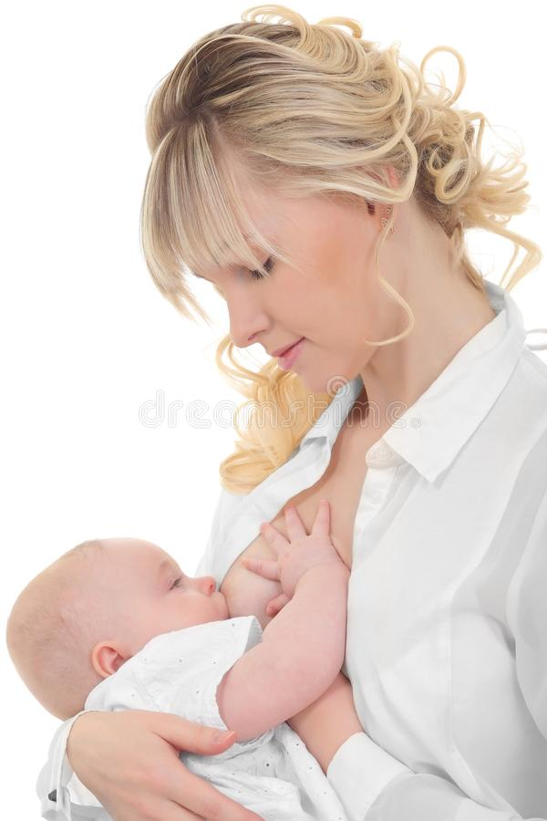 Mother breast feeding her child stock photo