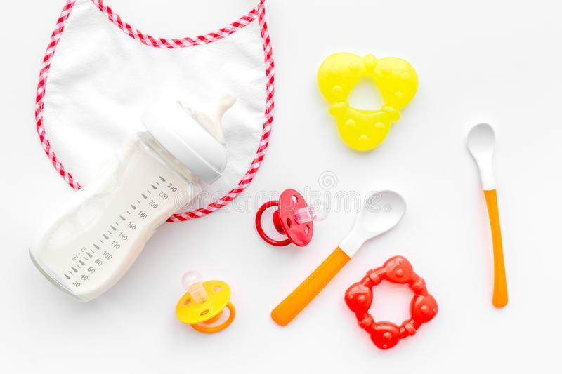 Mother care breast milk in bottle and infant formula powdered healthy food for baby feeding on white background top view. Mother care breast milk in bottle and royalty free stock photography