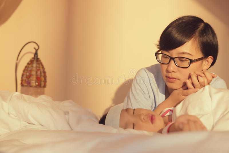Mother care sick son stock photography