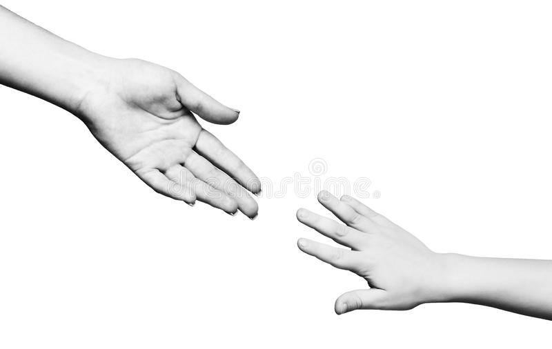 Mother caring her child holding him palm. Give me your hand. Mother caring her child holding him palm, black and white, panorama, copy space stock photo