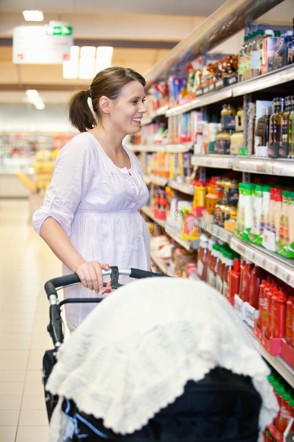 Download Mother With Carriage In Supermarket Stock Image - Image: 19560557