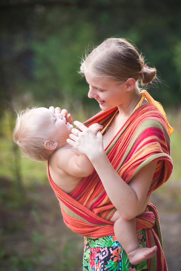 Free Mother Carrying Daughter Royalty Free Stock Photo - 16964415