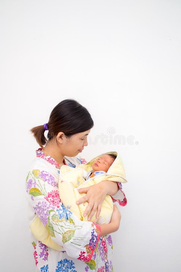 Mother Carrying Her Baby royalty free stock photos