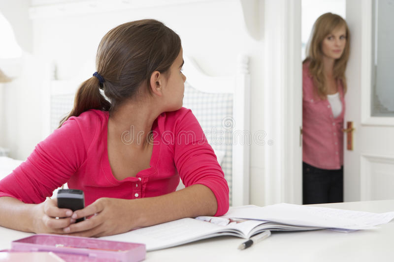 Mother Catches Daughter Using Phone When Meant To Be Studying royalty free stock photography