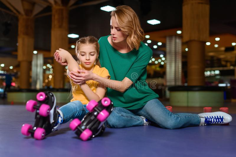mother cheering up injured daughter royalty free stock images