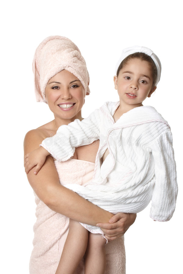 Mother and child after bath. Happy mother holding daughter after bath royalty free stock image