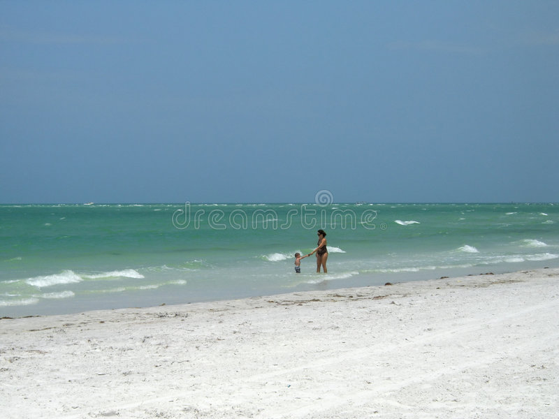 Mother and child on beach. Mother and child playing in warm golf of mexico on the florida beach in summer time stock photo