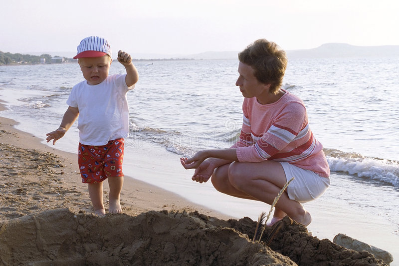 Mother and child on a beach royalty free stock photo