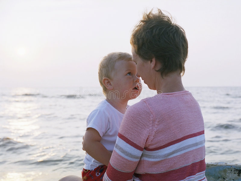 Mother and child on a beach stock photo